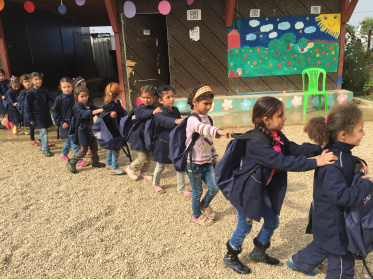 Syrian children are assisted in a Lebanese refugee camp.<div class='url' style='display:none;'>/en/</div><div class='dom' style='display:none;'>kirchgemeinde.ch/</div><div class='aid' style='display:none;'>392</div><div class='bid' style='display:none;'>12188</div><div class='usr' style='display:none;'>235</div>
