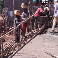 DR Congo —  Help for self-help: Through the purchase of building materials, the aid organisation in Bagira enables people to build a school building.